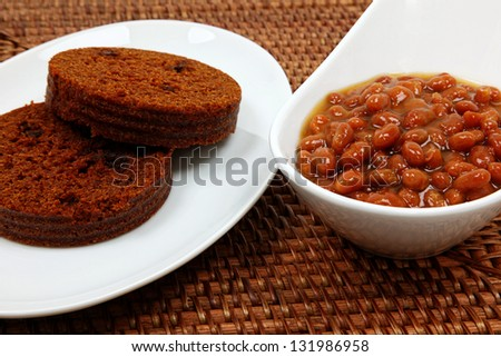 Baked Beans And Brown Bread On Table - stock photo