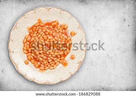 Baked Beans on a plate. - stock photo