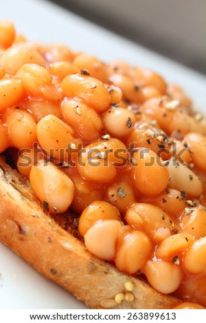 baked beans on toast with ground black pepper