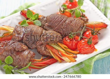 Baked Beef Steak Rolls with a vegetables - stock photo
