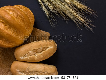 baked bread on black background, Top view