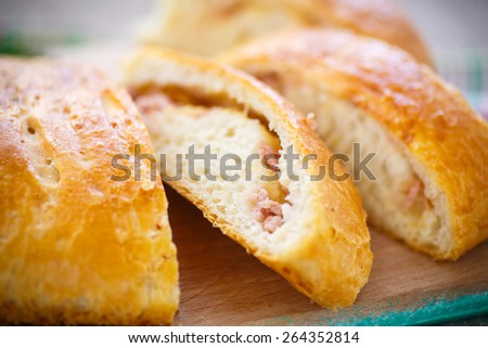 baked bread stuffed with cheese and sausage - stock photo