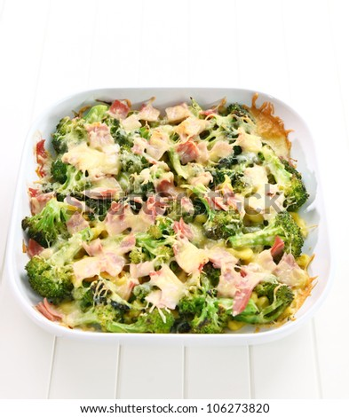Baked broccoli with ham and cheese - stock photo