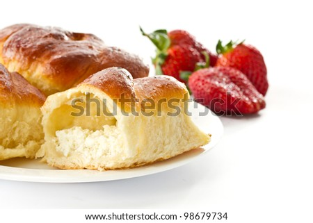 baked cakes with cream cheese on a white background