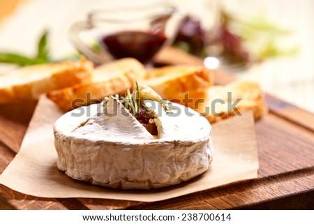 Baked Camembert cheese - stock photo