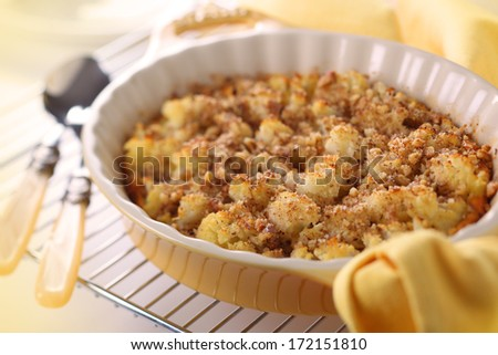 Baked cauliflower with cheese and nuts  - stock photo