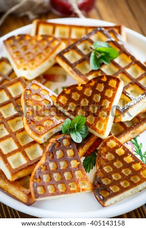 baked cheese waffles with powdered sugar - stock photo