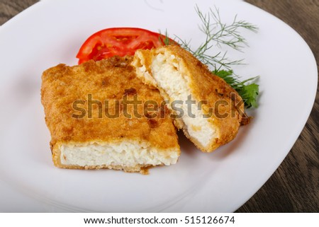 Baked cheese with dill leaves and tomato