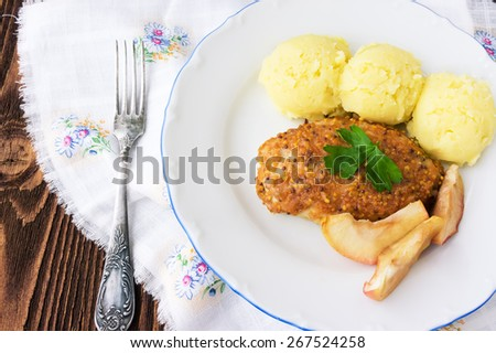 Baked chicken cutlet with apples, selective focus - stock photo