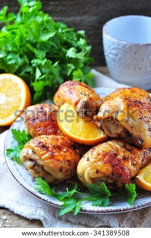 Baked chicken drumstick with orange, smoked paprika, Provencal herbs and olive oil. - stock photo