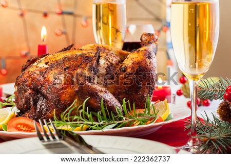 Baked chicken for Christmas dinner on festive table