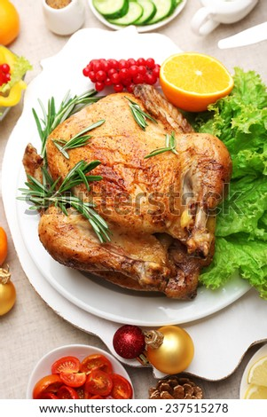Baked chicken for festive dinner. Christmas table setting - stock photo