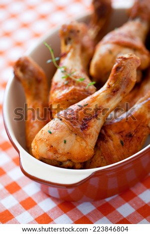 Baked chicken legs, selective focus - stock photo