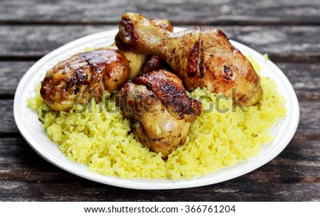 Baked chicken legs with yellow rice
