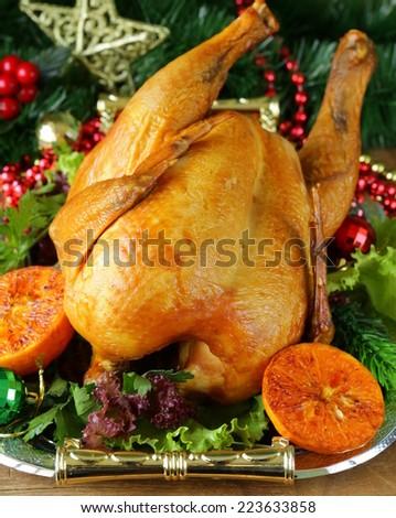 baked chicken or turkey for festive dinner, Christmas table setting - stock photo