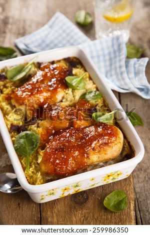 Baked chicken with rice and mango glaze - stock photo