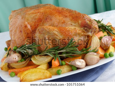 Baked chicken with vegetables and whole rosemary