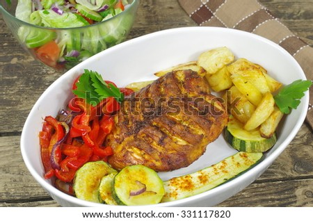 baked chicken with vegetables on board  background - stock photo