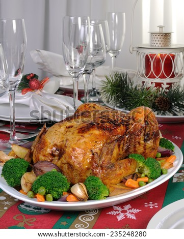 Baked chicken with vegetables on the festive table
