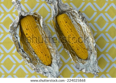 Baked corn on the cob - stock photo