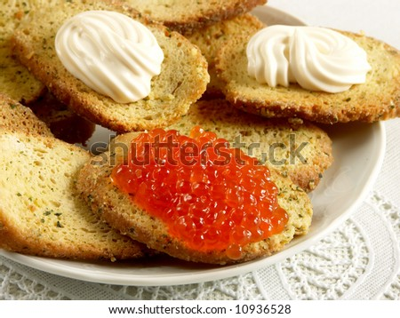 baked crusty toast with caviar - stock photo