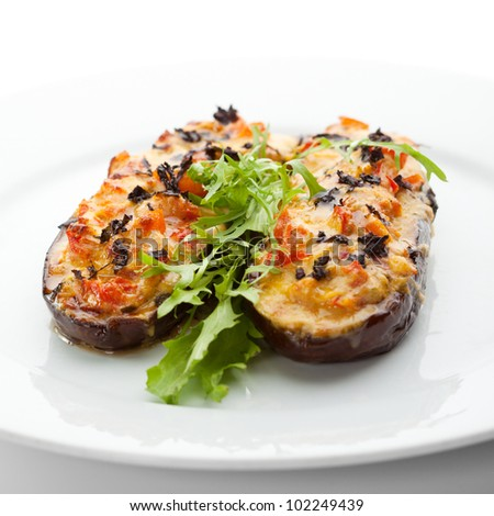 Baked Eggplant with Vegetables. Garnished with Fresh Greens