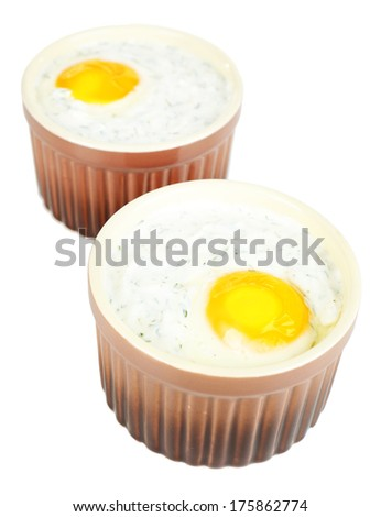 Baked eggs isolated on white