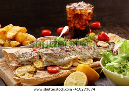 Baked fish with roasted potatoes and salad