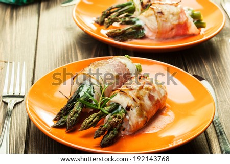 Baked fresh asparagus wrapped in chicken and bacon