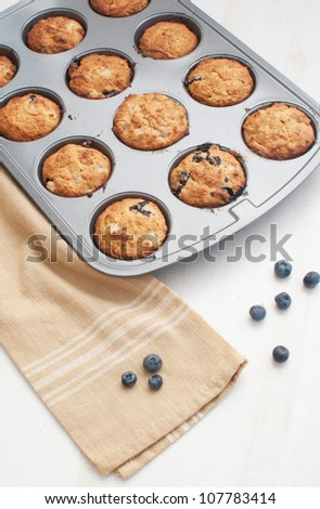 baked fresh muffins in metal baking mold - stock photo