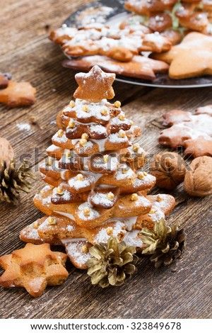 Baked gingerbread christmas tree on wooden background - stock photo