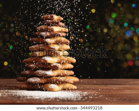 Baked gingerbread christmas tree on wooden background. Close-up - stock photo