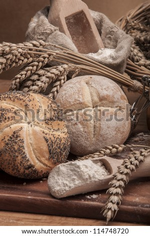Baked goods on wooden table and brown background