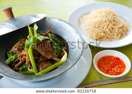baked goose with green beans ,potato,red pepper , green herbs, chinese noodle and sauce