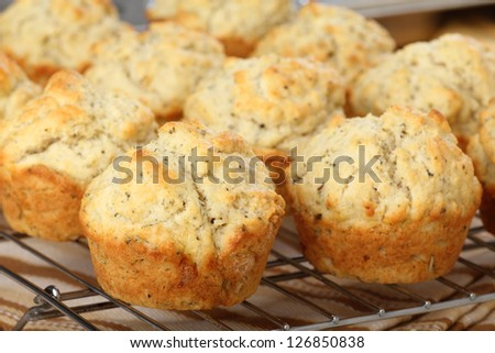 Baked herb muffins on a cooling rack