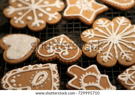 Baked Holiday Cookies with White Decorative Icing