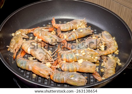 Baked king prawns in pan, Heap of baked shrimps - stock photo