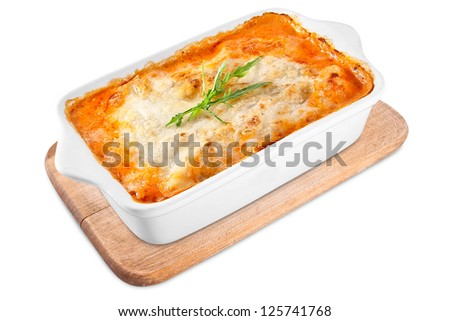 Baked lasagna in ceramic casserole dish - stock photo