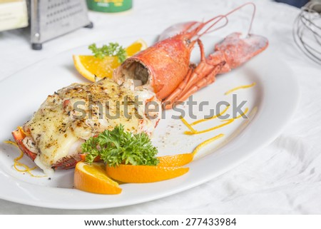 Baked lobster with cheese - stock photo