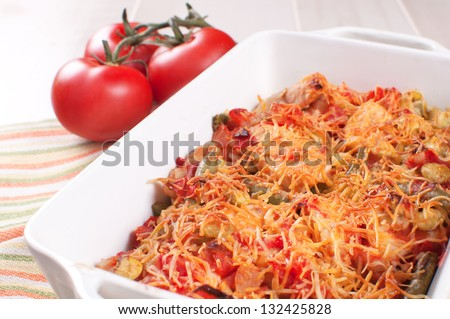Baked meat and vegetables casserole with cheese close-up - stock photo