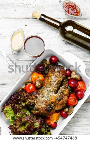 Baked meat and wine.Form baked meat loaf of veal with plum sauce,seasoning and wine - stock photo