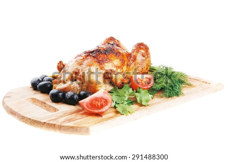 baked meat : homemade turkey with black olives and raw tomatoes on wooden board isolated over white background - stock photo