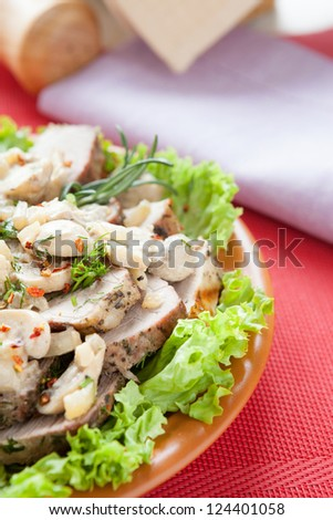 baked meat with mushrooms and cream, close up