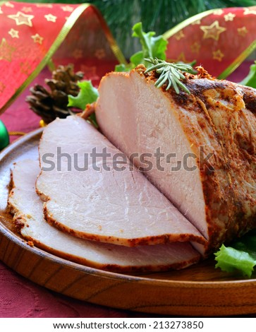 baked meat with paprika and rosemary, festive table setting - stock photo