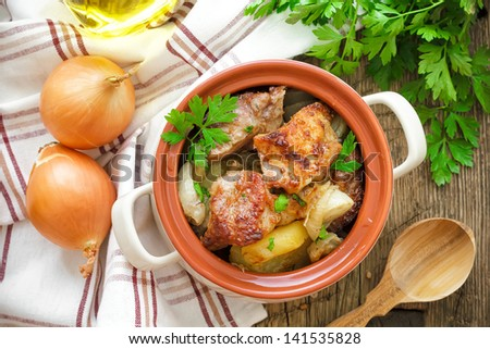 Baked meat with potato - stock photo