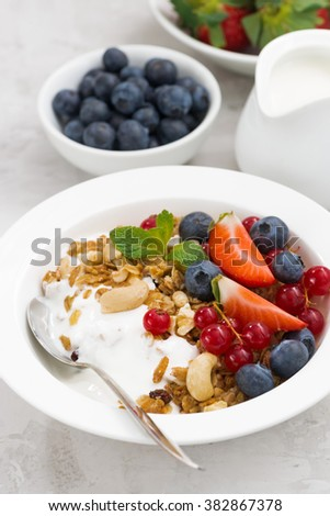 Baked muesli with fresh berries and yogurt, vertical, closeup