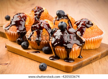 baked muffins covered liquid chocolate