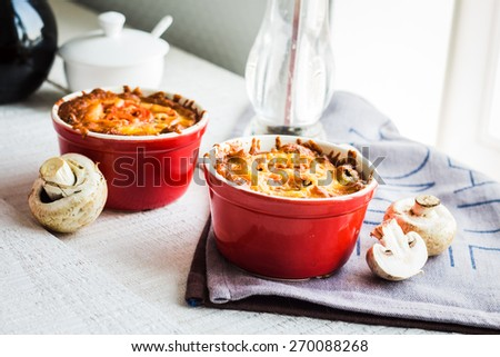 Baked mushroom julienne with cheese, vegetarian lunch on a white background