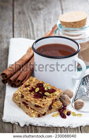 Baked oatmeal bars with cinnamon hot chocolate - stock photo