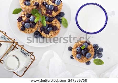 Baked oatmeal muffins with blueberry served with milk - stock photo